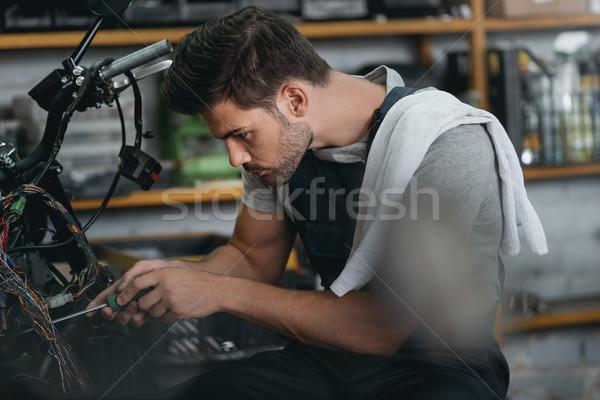 mechanic repairing motorbike Stock photo © LightFieldStudios