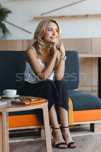Stock photo: smiling businesswoman in cafe