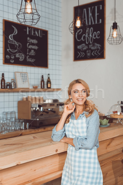 beautiful cafe owner in apron Stock photo © LightFieldStudios