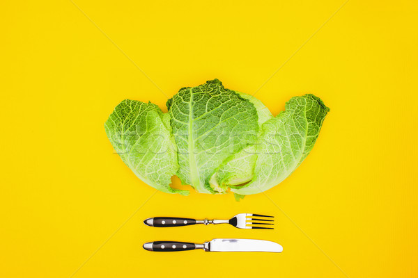 top view of fresh healthy cabbage and fork with knife isolated on yellow Stock photo © LightFieldStudios