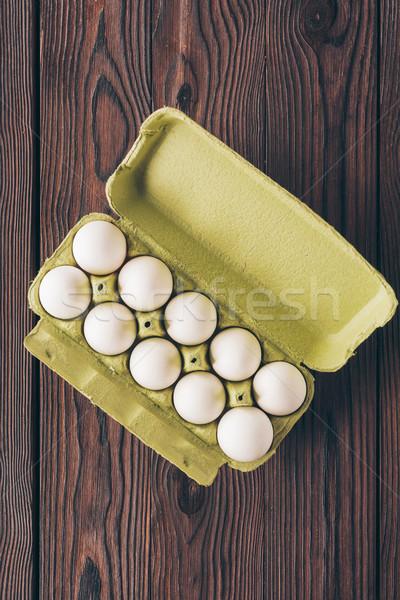 Top мнение куриные яйца лоток деревянный стол Сток-фото © LightFieldStudios