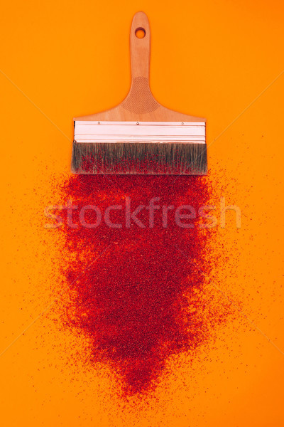 top view of red sand for decoration and brush isolated on orange Stock photo © LightFieldStudios