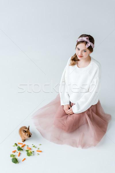 Stock fotó: Imádnivaló · lány · mosolyog · kamera · etetés · nyúl