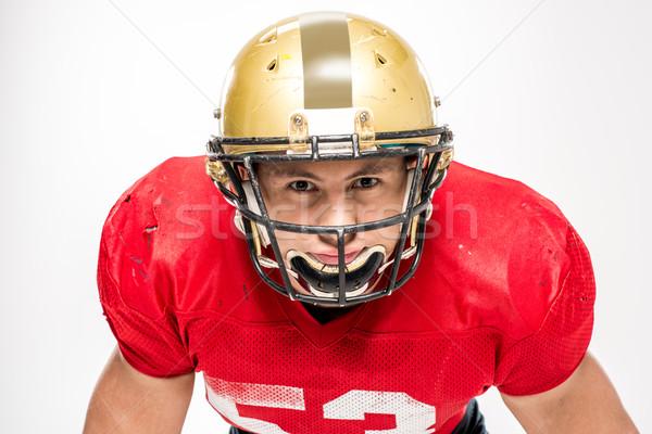 Amerikai futballista sisak sportruha néz kamera Stock fotó © LightFieldStudios