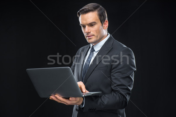 Businessman using laptop Stock photo © LightFieldStudios