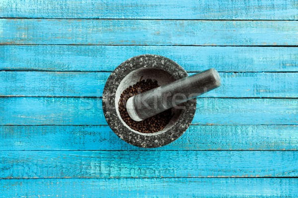 mortar and pestle on table Stock photo © LightFieldStudios