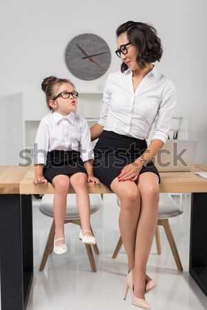 side view of shocked professional doctors in medical uniforms using laptop in cabinet Stock photo © LightFieldStudios