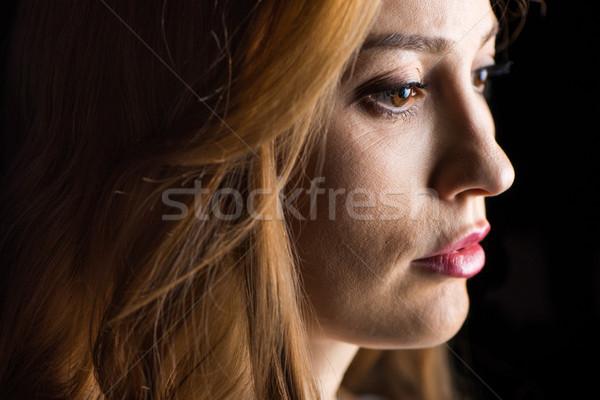 Sérieux jeune femme vue de côté noir femme Photo stock © LightFieldStudios