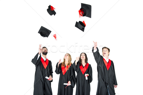 Felice giovani studenti laurea isolato Foto d'archivio © LightFieldStudios