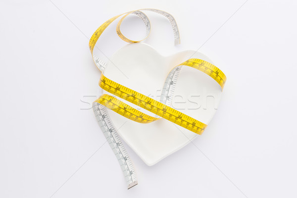 measuring tape wrapped around plate isolated on white, healthy living concept Stock photo © LightFieldStudios