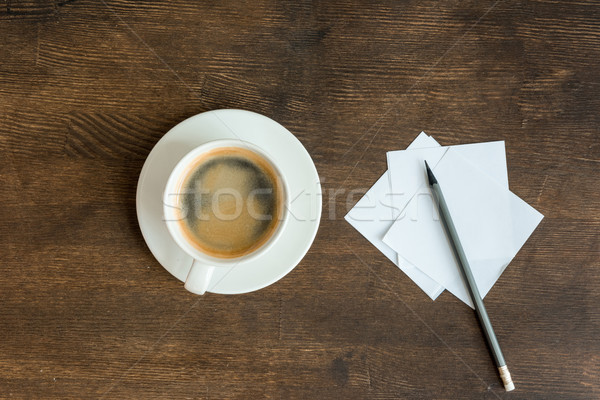 Top view of blank papers with pencil and cup of coffee on wooden table top Stock photo © LightFieldStudios