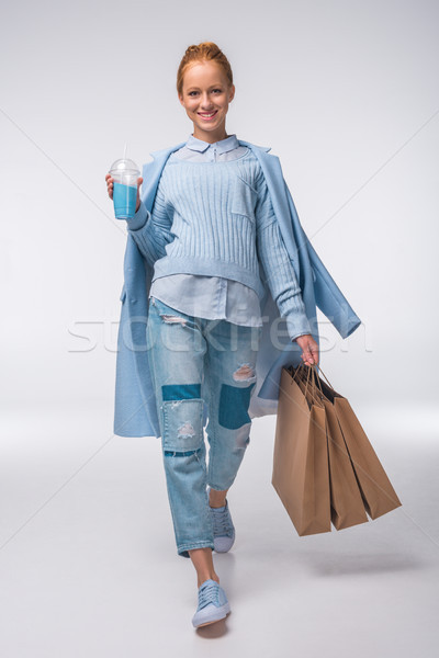 girl in blue with shopping bags Stock photo © LightFieldStudios