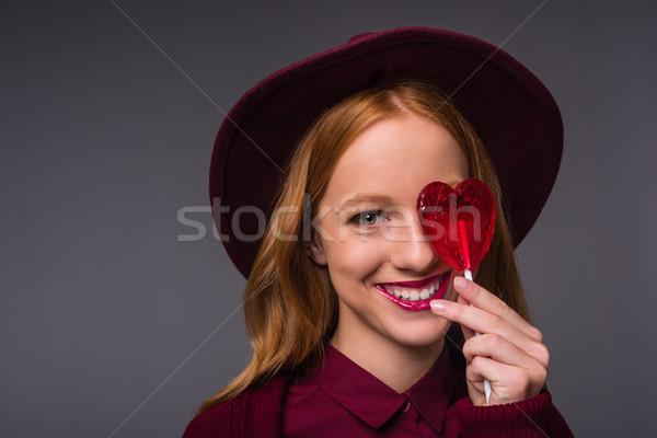 Lány kalap nyalóka gyönyörű vörös hajú nő elegáns Stock fotó © LightFieldStudios