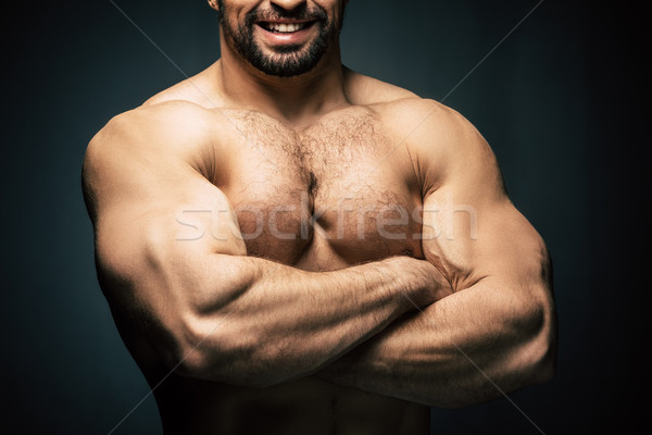 shirtless sportive man showing muscles Stock photo © LightFieldStudios