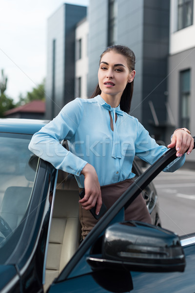 businesswoman walking out of car Stock photo © LightFieldStudios