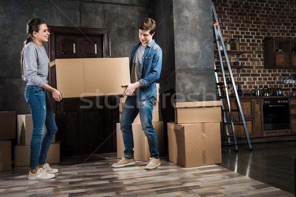 couple holding cardboard box together Stock photo © LightFieldStudios