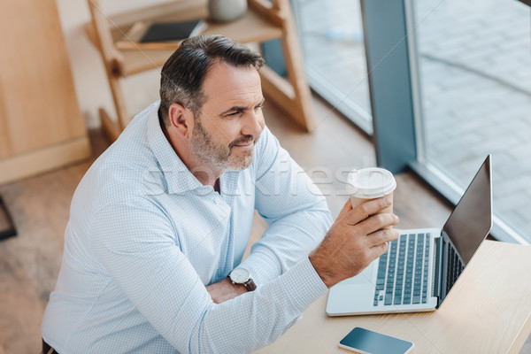businessman with disposable cup of coffee Stock photo © LightFieldStudios