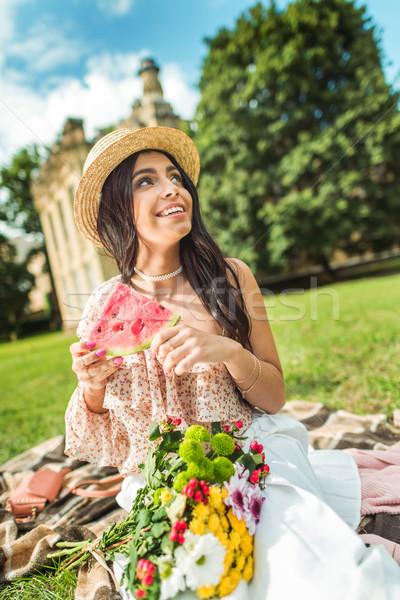 Menina alimentação melancia belo sorridente mulher jovem Foto stock © LightFieldStudios