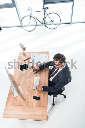 businessman working with desktop computer Stock photo © LightFieldStudios