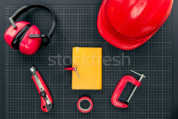 Construction equipment and notebook Stock photo © LightFieldStudios