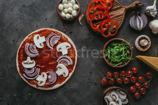 top view of unprepared pizza with ingredients on concrete surface Stock photo © LightFieldStudios
