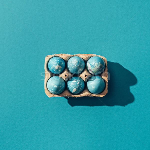 top view of blue easter eggs in tray, on blue Stock photo © LightFieldStudios