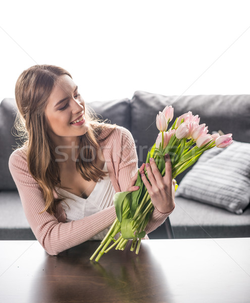 Woman with fresh flowers Stock photo © LightFieldStudios