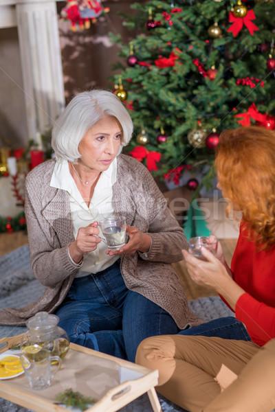 Two women drinking tea  Stock photo © LightFieldStudios