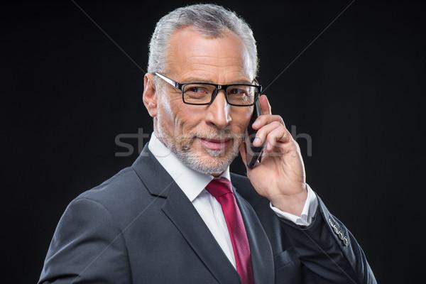 Businessman using smartphone Stock photo © LightFieldStudios