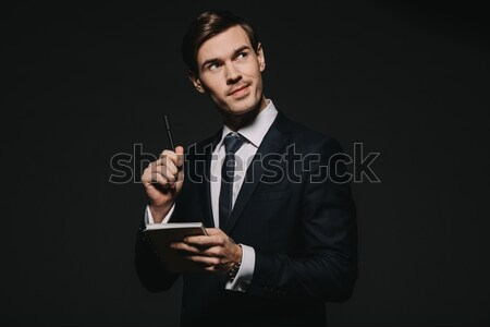 Businessman using smartphone Stock photo © LightFieldStudios