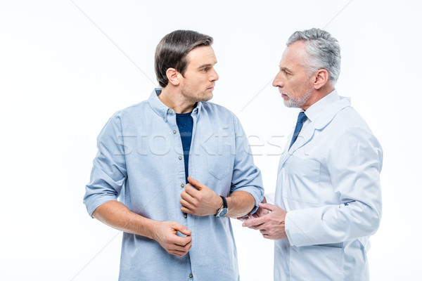 Doctor chatting with patient Stock photo © LightFieldStudios