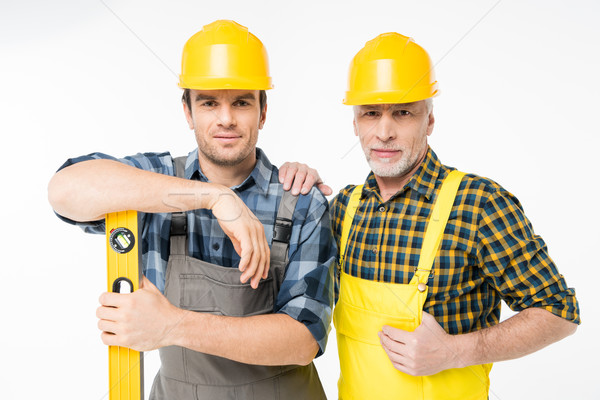 Workmen with level tool Stock photo © LightFieldStudios