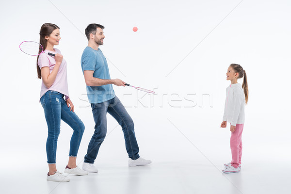 smiling family playing badminton with rackets and shuttlecock on white   Stock photo © LightFieldStudios