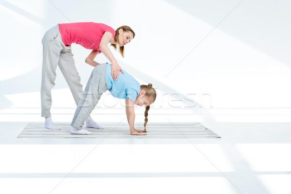 Mutlu genç anne egzersiz kız yoga mat Stok fotoğraf © LightFieldStudios
