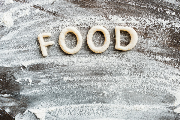 Top view of edible word food made from sweet crunchy cookies, baking cookies concept Stock photo © LightFieldStudios