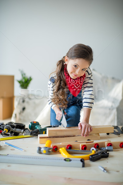 Little girl with tools Stock photo © LightFieldStudios