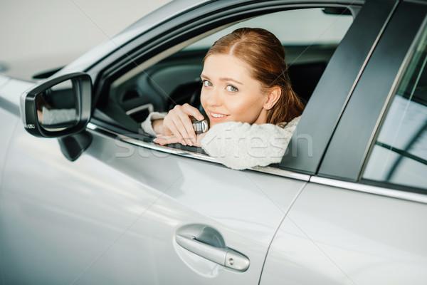 привлекательный улыбаясь сидят Новый автомобиль Сток-фото © LightFieldStudios