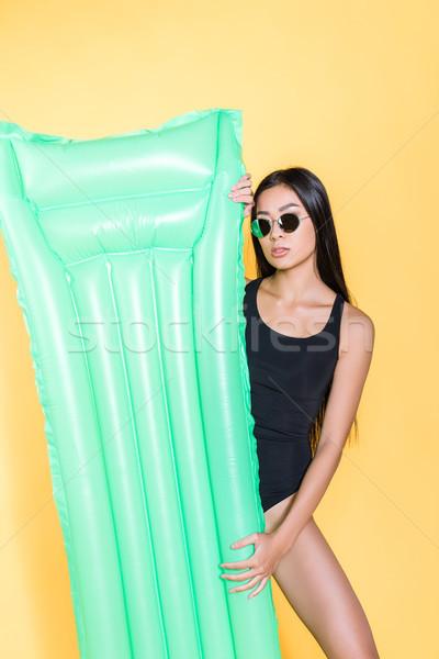 woman in swimsuit with pool mattress Stock photo © LightFieldStudios