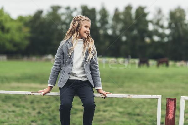child sitting on fence Stock photo © LightFieldStudios