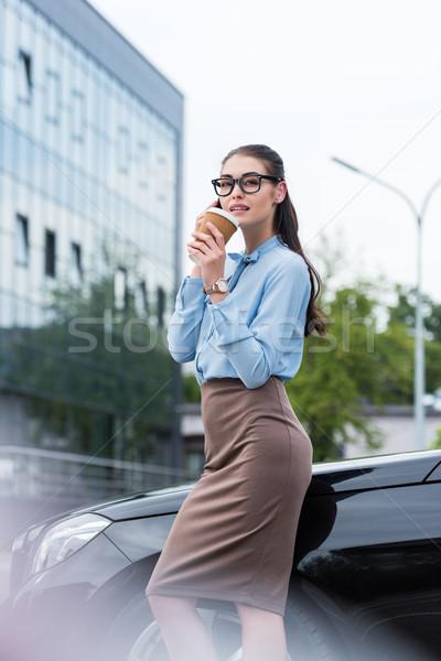 businesswoman talking on smartphone with coffee Stock photo © LightFieldStudios