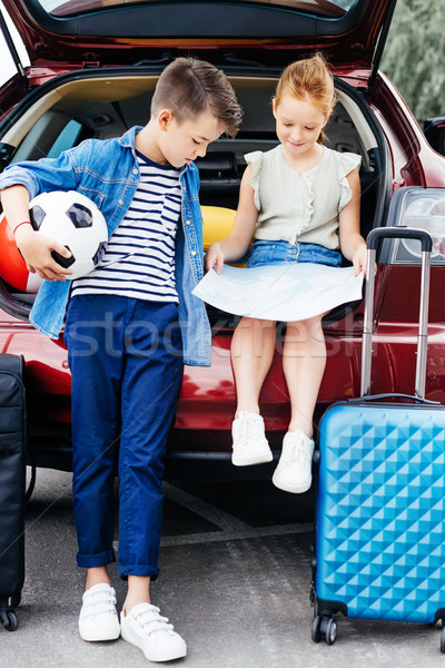 brother and sister in trunk of car Stock photo © LightFieldStudios