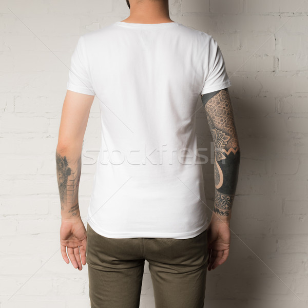 man in blank white t-shirt Stock photo © LightFieldStudios