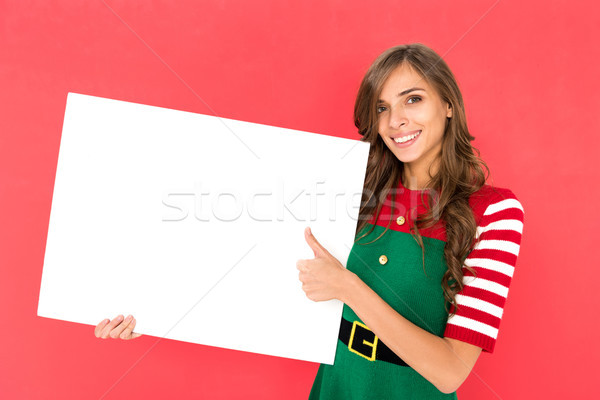 woman in elf costume with banner Stock photo © LightFieldStudios