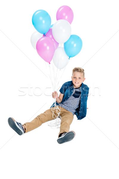 boy holding balloons Stock photo © LightFieldStudios