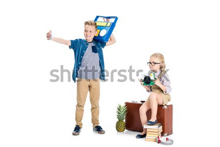 kids taking selfie with various objects Stock photo © LightFieldStudios