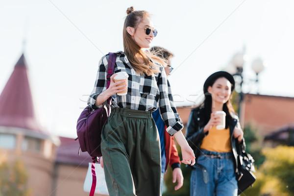 Multikulturális barátok kávé kezek sétál utca Stock fotó © LightFieldStudios