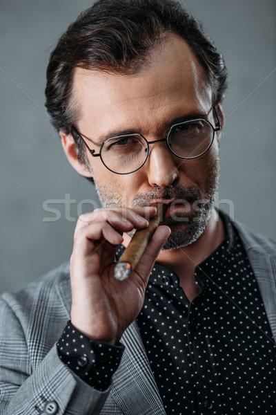 Stock photo: businessman smoking cigar