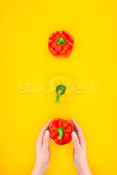 top view of human hands and fresh raw peppers isolated on yellow Stock photo © LightFieldStudios
