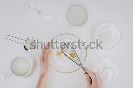 cropped shot of person preparing dough while cooking pancakes isolated on grey Stock photo © LightFieldStudios