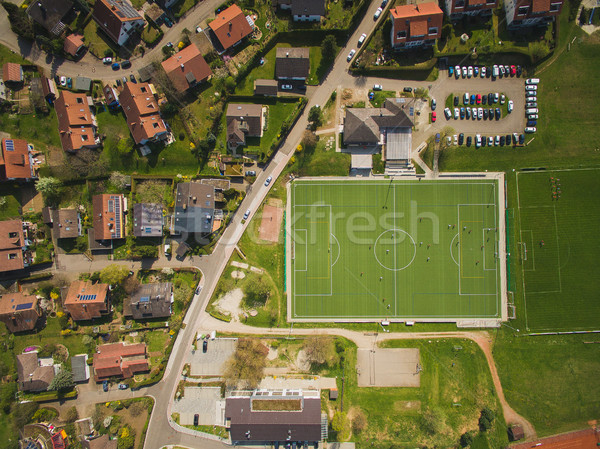 Aerial view of city and green soccer stadium in Germany Stock photo © LightFieldStudios